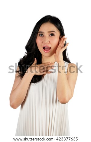 Shocked woman wearing white dress looking at camera and white background - stock photo