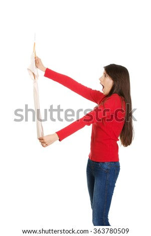 Shocked woman with a new shirt. - stock photo