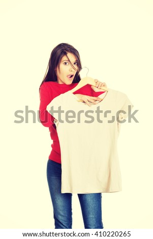 Shocked woman with a new shirt.