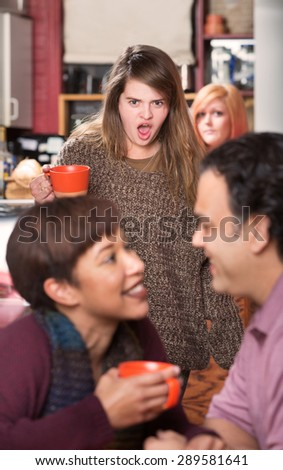Shocked woman with coffee finding boyfriend in cafe - stock photo