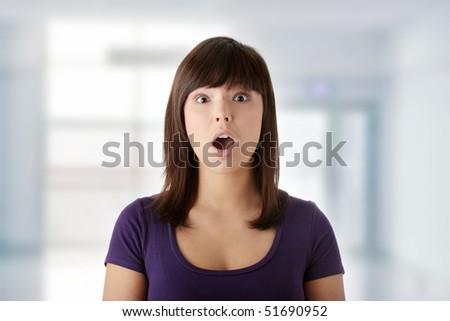 Shocked young beautiful woman - stock photo