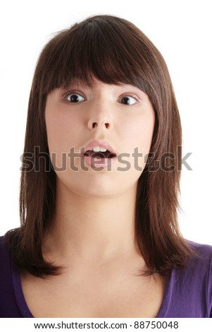 Shocked young beautiful woman isolated on white background - stock photo