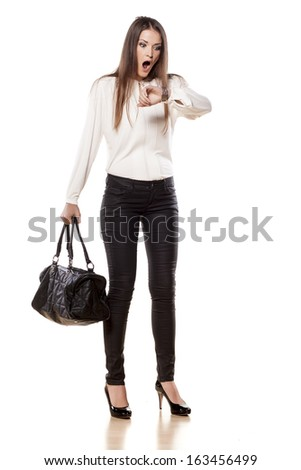shocked young business woman looking at her watch - stock photo