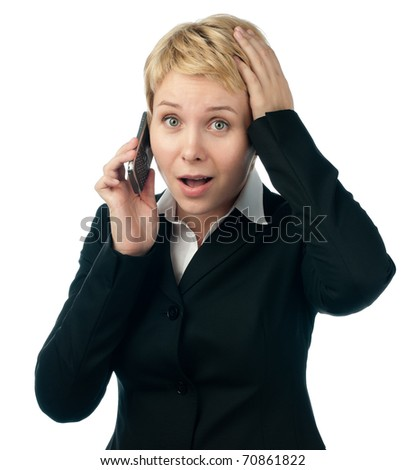 shocked young business woman, looking into the camera, talking on mobile phone. Isolated on white background