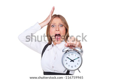 shocked young businesswoman holding the alarm clock. isolated on white background - stock photo