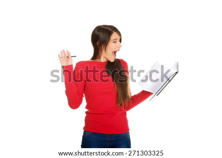 Shocked young student woman with her note. - stock photo