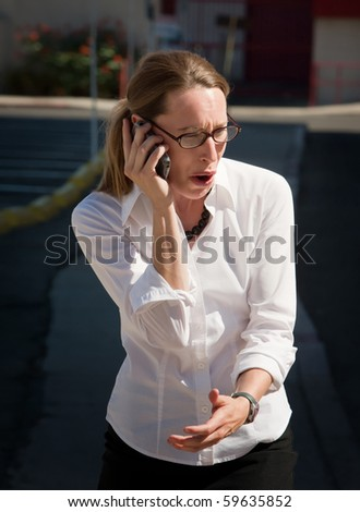 Shocked young woman is amazed at what she is hearing. - stock photo