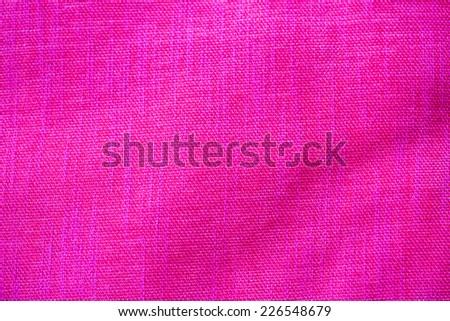 Shocking pink fabric background   - stock photo