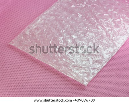 Shockproof material - Air Bubble Sheet on pink background