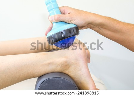 Shockwave therapy increases the growth of new blood vessels and is for instance used for treating calcific tendonitis or chronic tendonitis in the foot, elbow, knee or shoulder  - stock photo