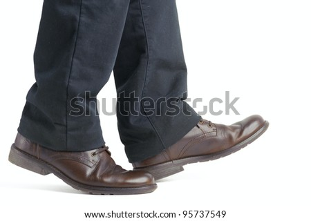 shoe and leg of a businessman caution step - stock photo