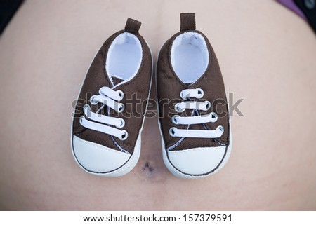 Shoe for baby, Pregnant