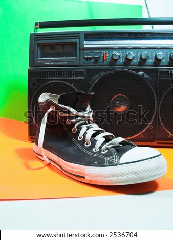Shoe in in front of vintage Radio (focus on the shoe) - stock photo