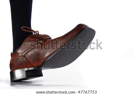 Shoe of a businessman with determined step. Wide angle