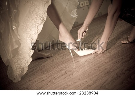 shoe of the bride in retro style - stock photo