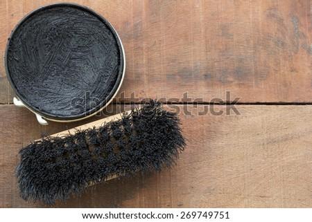 shoe polish and brush  on wood - stock photo