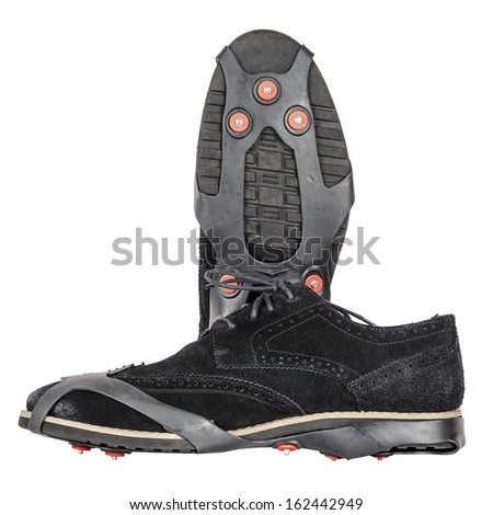 Shoe spikes imposed on shoes, to increased safety for snow and ice - stock photo