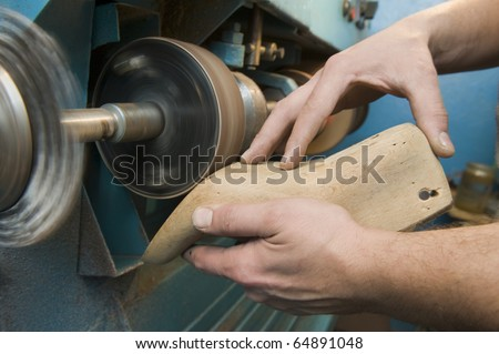 Shoemaker is repairing boot-tree - stock photo