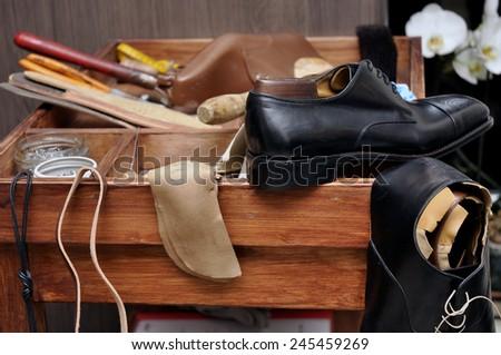 Shoemaker tools. Shoemaker workshop - stock photo