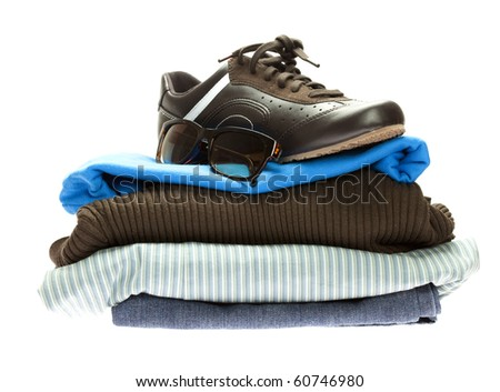 shoes and a mountain of clothes isolated on white - stock photo