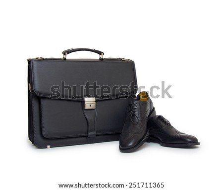 Shoes and bag on white background - stock photo