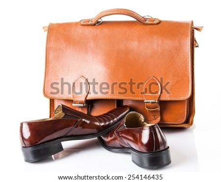 Shoes and bag on white background. - stock photo