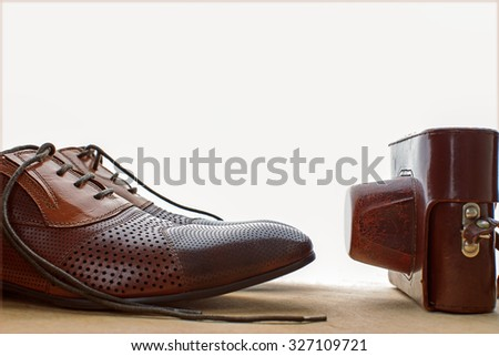 Shoes and camera. Old fashion style  - stock photo