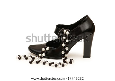 Shoes and necklace  isolated on the white