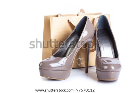 Shoes and shopping bag isolated on white - stock photo