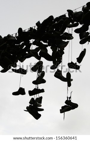 Shoes and sneakers above the street - stock photo