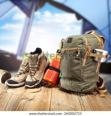 shoes backpack and table of wood  - stock photo