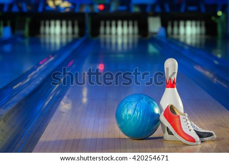shoes, bowling pin and ball for bowling game - stock photo