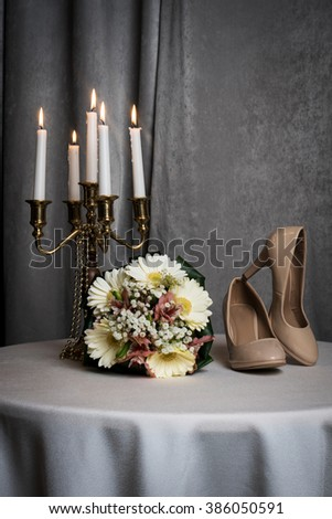 shoes, bride's bouquet and chandelier