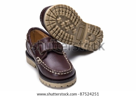 Shoes for kids isolated over a white background. - stock photo