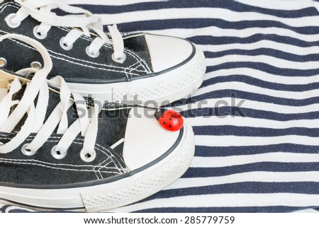 shoes ladybug spring summer sailor's striped shirt sea vacation selective soft focus - stock photo