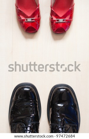 shoes of a man and a woman standing opposite on the floor