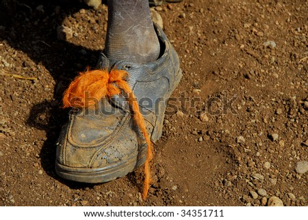 shoes of a poor child - stock photo