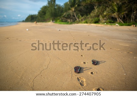 shoes on beach - stock photo