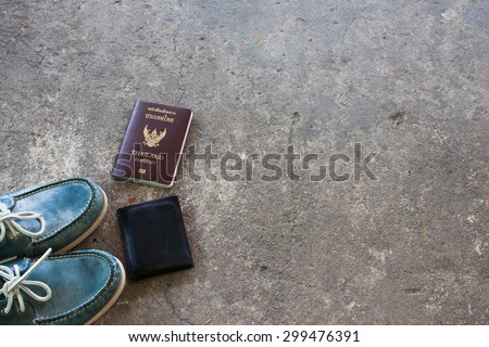 Shoes on the cement floor. and passport ready to go travel.wallet. - stock photo