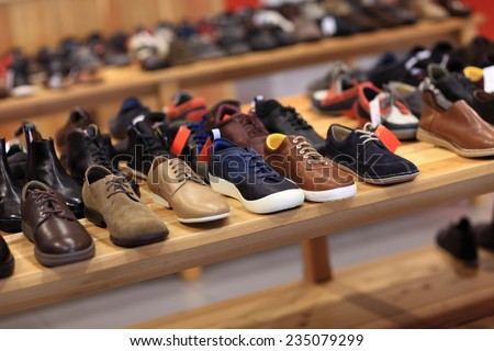 Shoes on the wooden shelf in the store - stock photo