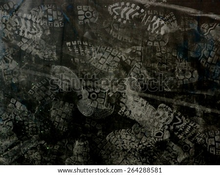 Shoes print on dark background. - stock photo