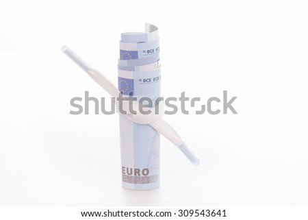 Shoestring budget concept with Euro banknotes  - stock photo