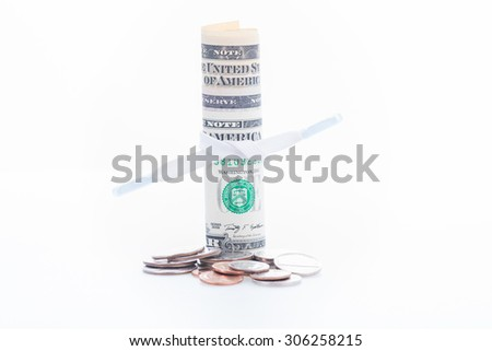 Shoestring budget concept with US dollar banknotes and coins over white background - stock photo