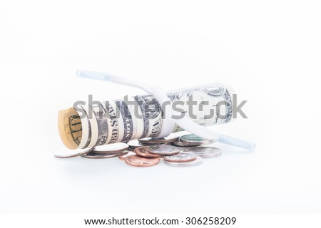 Shoestring budget concept with US dollars and coins close up  - stock photo