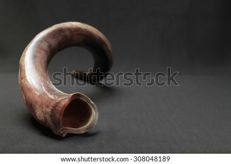 shofar ( ram horn  ) isolated over black background - stock photo