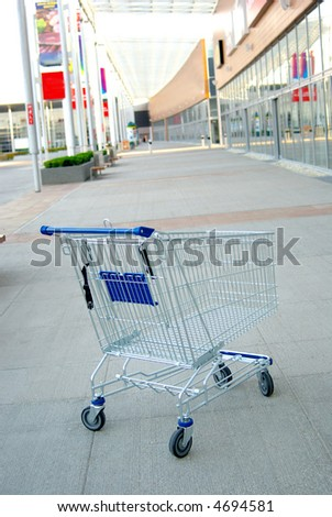 shooping cart outside  closed mall. No people. crisis - stock photo