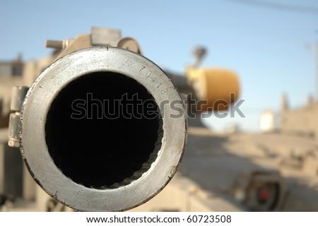 Shoot don't talk. Israeli Merkava 105 mm gun. - stock photo