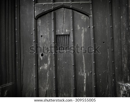 Shoot of a very old, gothic, wooden door ideal for use as a background that is dark and spooky. Many imperfections have been left in to add to the messy, old and authentic feel.