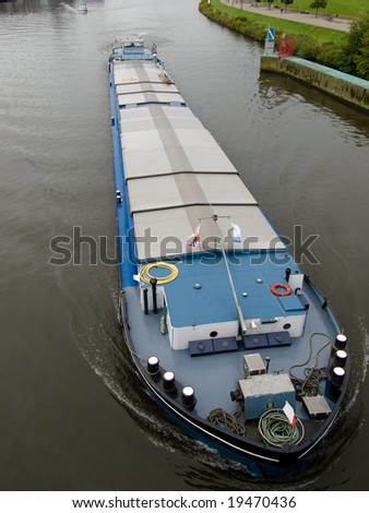 Shoot of big barge on Maas river from bridge in Netherlands. - stock photo
