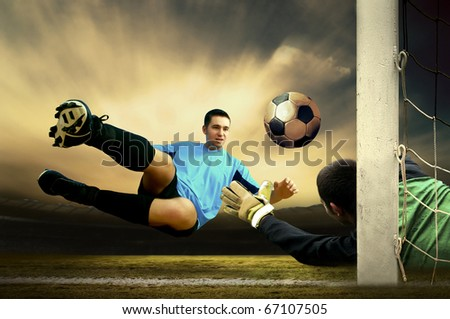 Shoot of football player and goalkeeper - stock photo